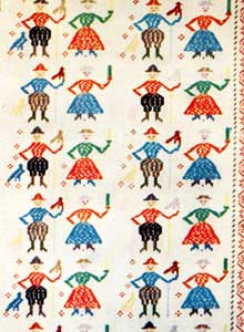 Traditional bedspreads; Photography by Archivio TCI, La Sila of Ernesto De Martino and Franco Pinna; LEA: Roma, 1959. Beyond the goldsmith tradition, in the course of the History, the woven is the one that characterized the handicraft production of San Giovanni in Fiore, with bedspreads and trousseaus with strongly coloured geometrical motifs...